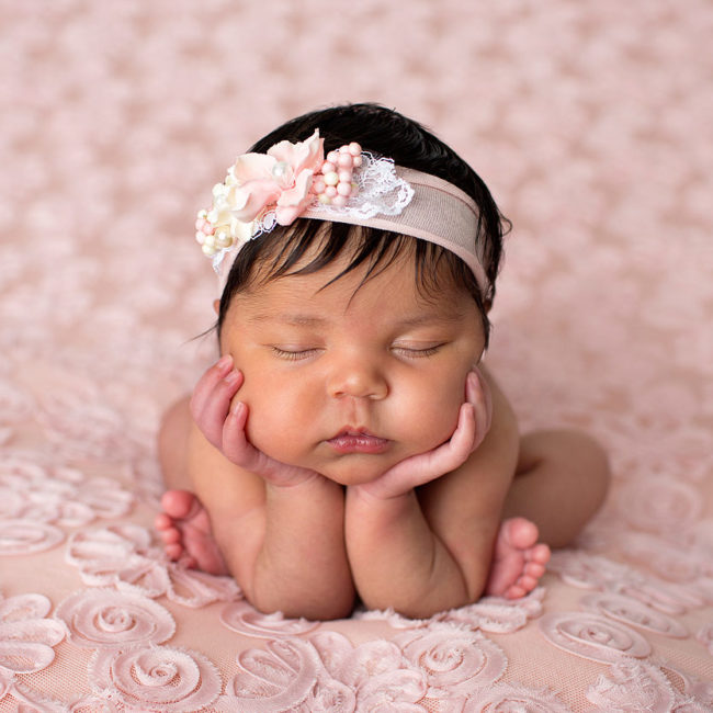 Newborn photographer vacaville baby girl posed on pink